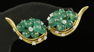 Pair of 18K yellow gold earrings, signed Cartier, with 18 natural emeralds. Price realized: $20,400. Kaminski Auctions image