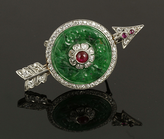 Art Deco Chinese-style platinum and carved jade pin with circular diamond border and cabochon rubies, circa 1920-'30s, marked 'T.B. Starr.' Price realized: $11,400. Kaminski Auctions image