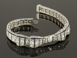 Platinum, diamond, and sapphire bow bracelet, diamonds approximately 8 carats. Price realized: $14,400. Kaminski Auctions image