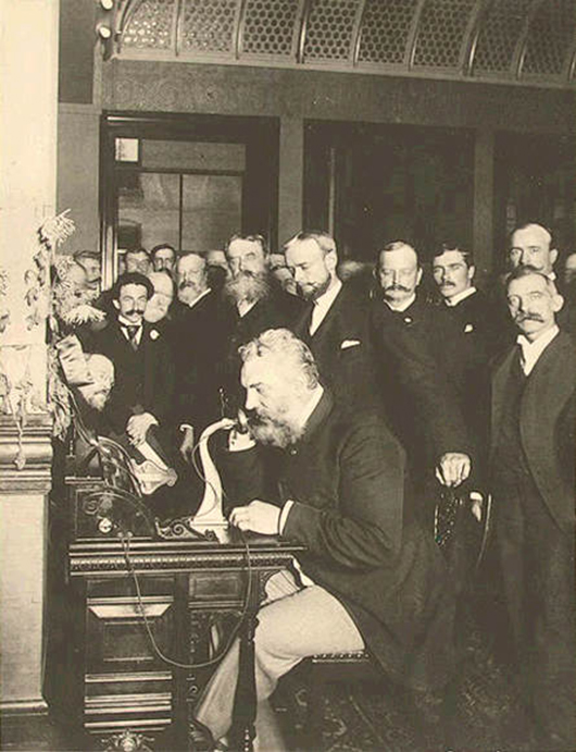 Bell at the opening of the long-distance line from New York to Chicago in 1892. Image courtesy of Wikimedia Commons