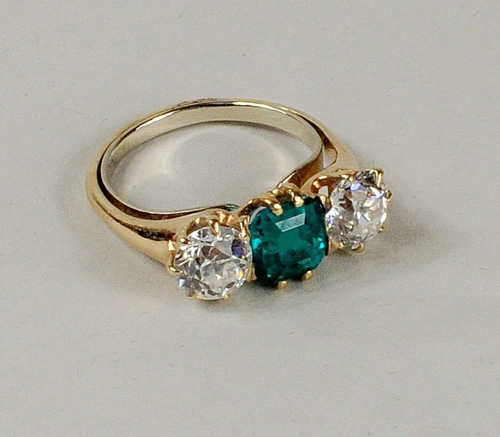 A European 18k Gold Cut Diamond And Emerald Ring Size 7 With Paired Diamonds One Carat Each An Center Stone Also About