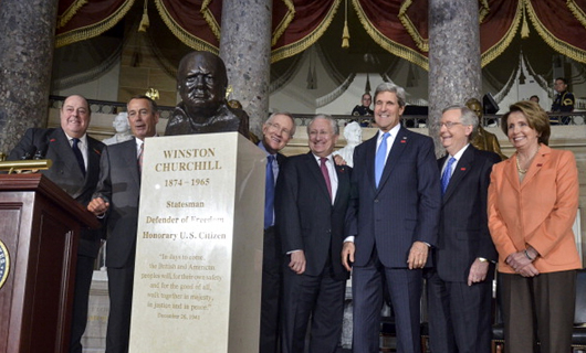 Secretary of State John Kerry and other members of the U.S. Senate assemble in 2013 beside a bust of Sir Winston Churchill by Oscar Nemon. The 50th anniversary of Churchill's funeral was marked with reverence in London this week. Image courtesy of Architect of the Capitol.