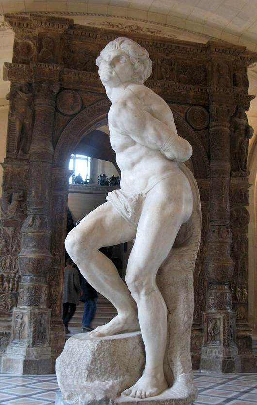 Michelangelo's 'Rebellious Slave,' at the Louvre, Paris. Image by Dada. This file is licensed under the Creative Commons Attribution 3.0 Unported license.