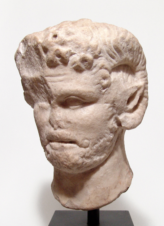 Greco-Roman marble head of satyr with attributes of Zeus-Ammon, circa 1st-2nd century AD, 9 inches, book example. Provenance: Charles Callahan Perkins collection (1823-1886). Ancient Resource image