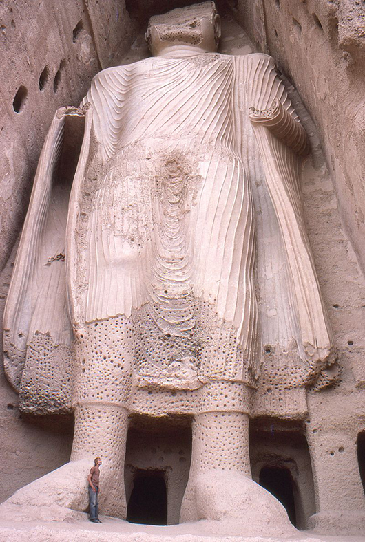 Thursday's destruction of the artifacts by jihadists in Iraq drew comparisons with the 2001 dynamiting of the Bamiyan buddhas in Afghanistan by the Taliban. Pictured is the smaller of the two Bamiyan buddhas before it was destroyed. Image by Phecda109, courtesy of Wikimedia Commons