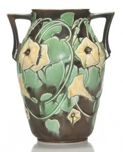 The Monsen-Baer Collection included many experimental pieces made at the factory. This Morning Glory glaze trial vase in a double-handle amphora shape has yellow blossoms on one side and white blue tinted blossoms on the reverse – final price $2,100 (est. $400-$600). Humler & Nolan image