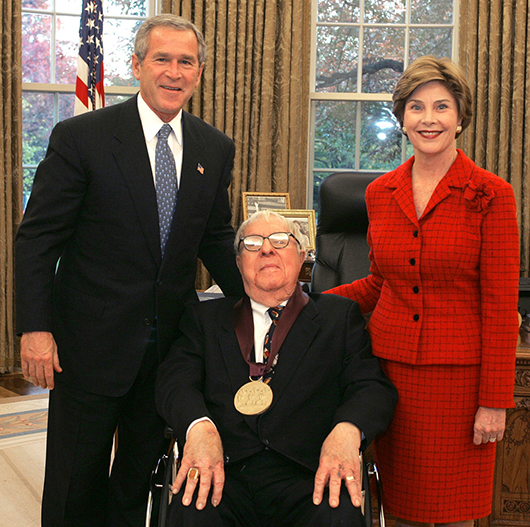 Ray Bradbury receives National Medal of Arts in 2004 at The White House, with President George W. Bush and First Lady Laura Bush. Photo by Susan Sterner
