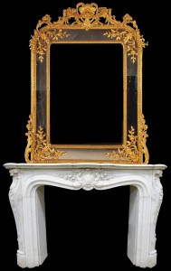 Ornate 19th century gold mirror perched above a magnificent statuary marble mantel, also 19th century. Historical Estates Auctions image