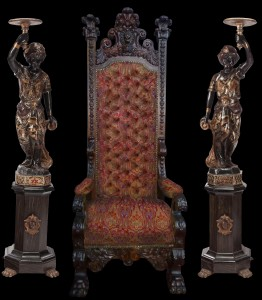 Nineteenth century throne chair, 8 feet tall, flanked on either side by Venetian blackamoors, also 19th century. Historical Estates Auctions image