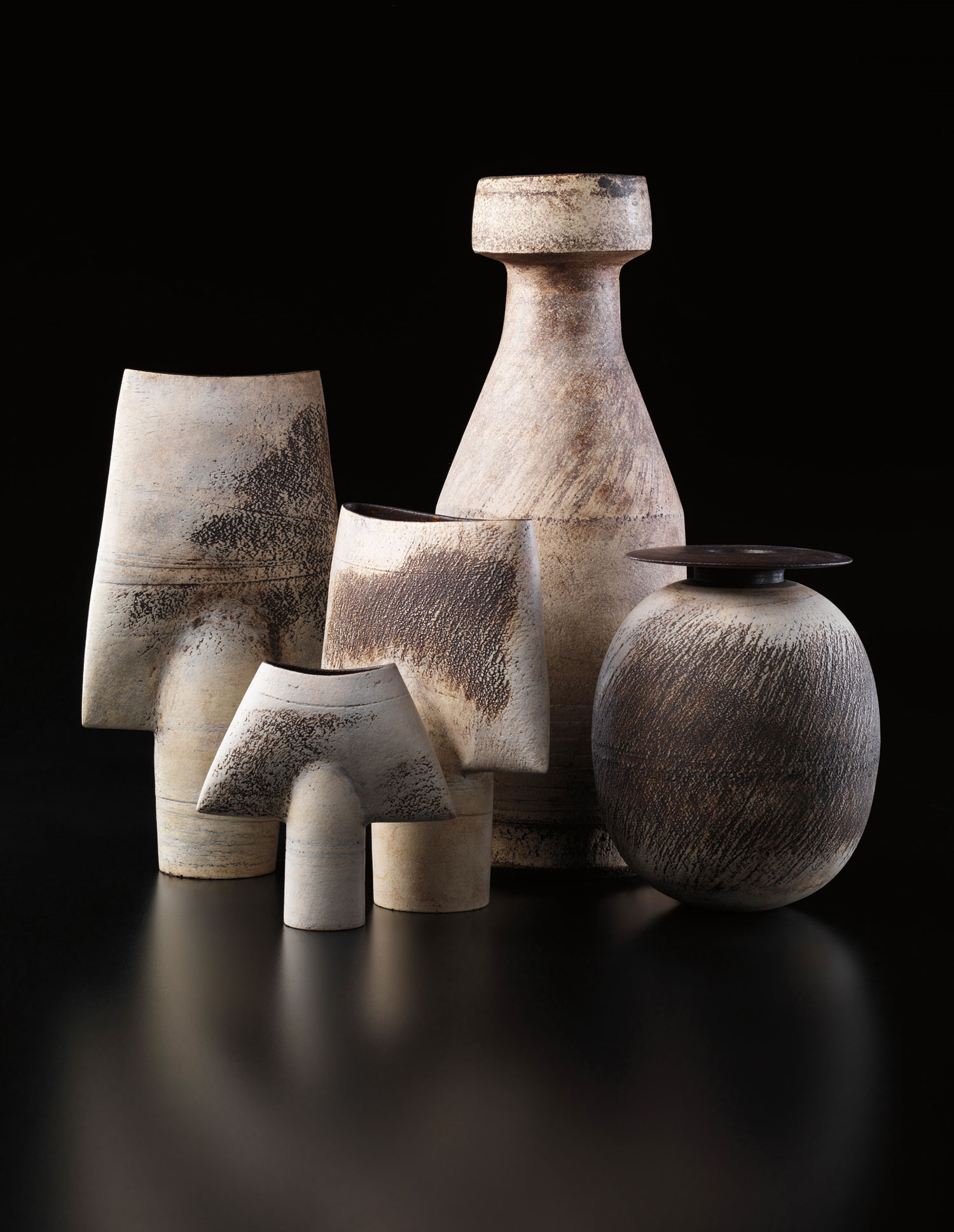 A carefully chosen selection of significant works by Hans Coper was assembled by influential American collectors Betty Lee and Aaron Stern. The Phillips New York sale of the collection in late 2013 established a new price scale for the artist's designs. In this grouping of vases, the ovoid form with disc top at right, made about 1969, brought $100,000. Phillips image