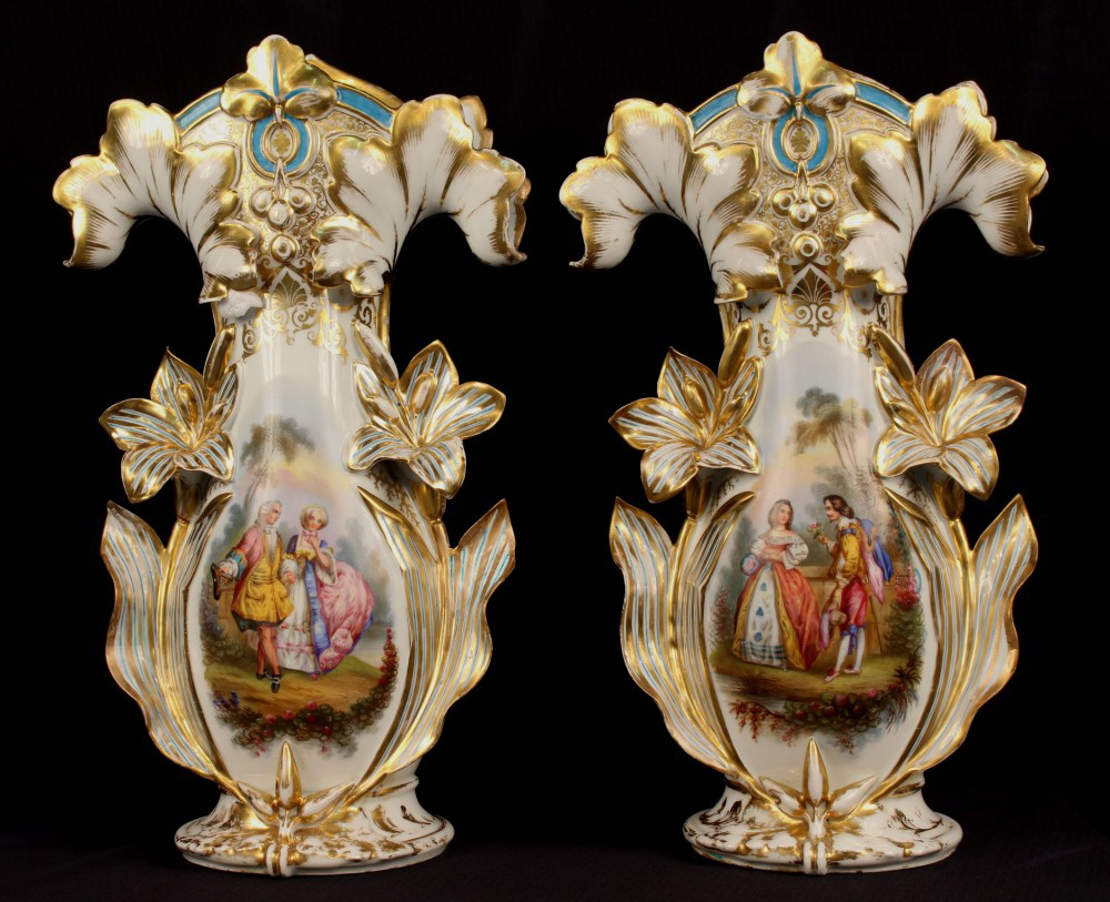 Large matched pair of Old Paris vases decorated with courting scenes and lily floral designs, 19 inches tall, circa 1860. Stevens Auction Co. images
