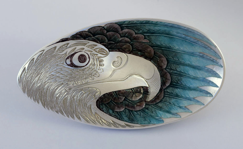 A spoon by Malcolm Appleby engraved with an eagle's head and enameled to represent its wings (London 2013). The information in brackets gives the assay office and year when the spoon was tested for silver content.