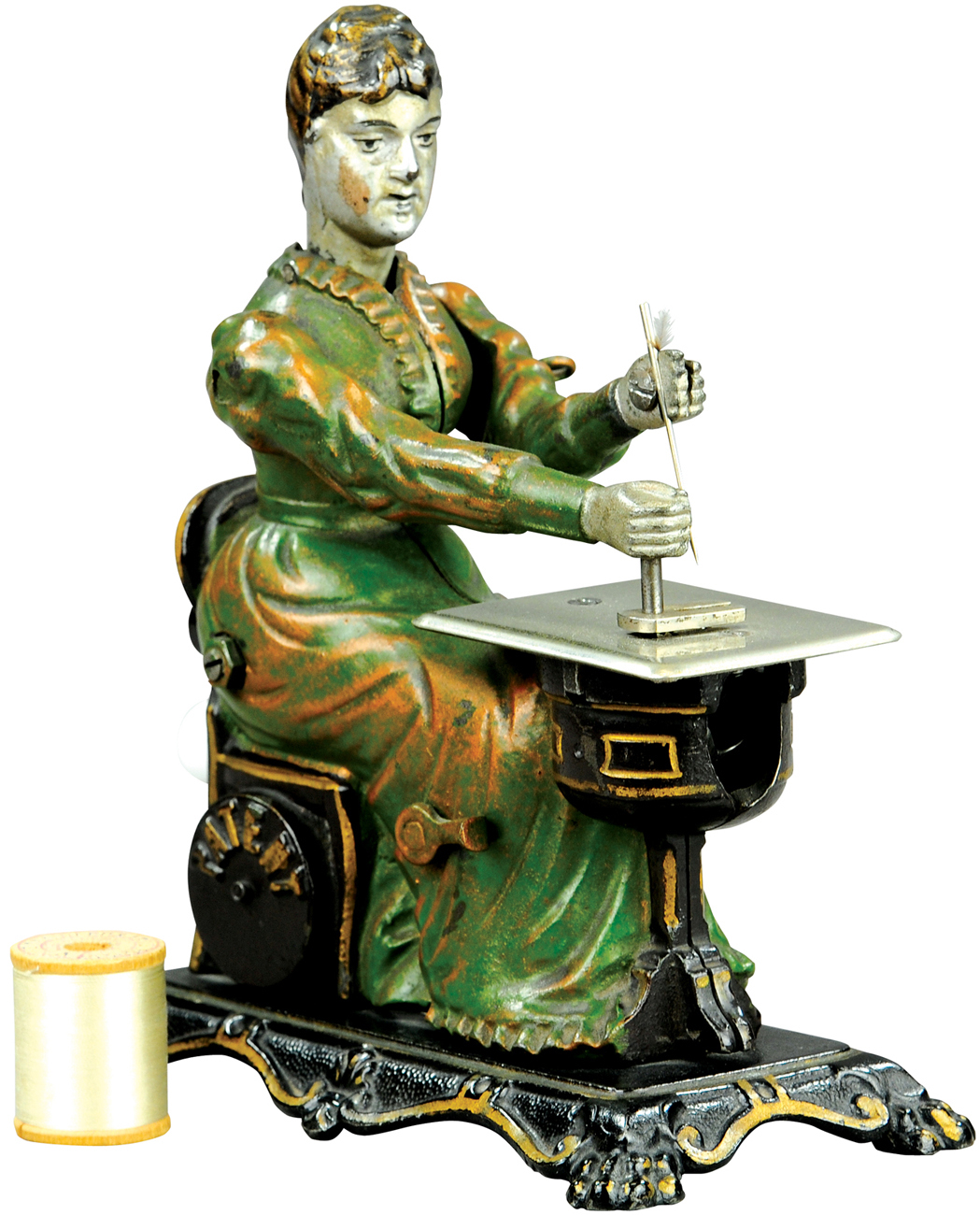 Cast-iron Woman at Sewing Machine, attributed to Sandt, rear lever activates head and hand when turned, provenance: Donal Markey Collection, $24,000. Bertoia Auctions image