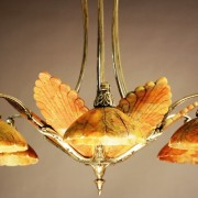 French Art Deco bronze and red alabaster chandelier, circa 1920, 30in x 16in. Estimate: $1,200-$1,800. Bruhns Auction Gallery images