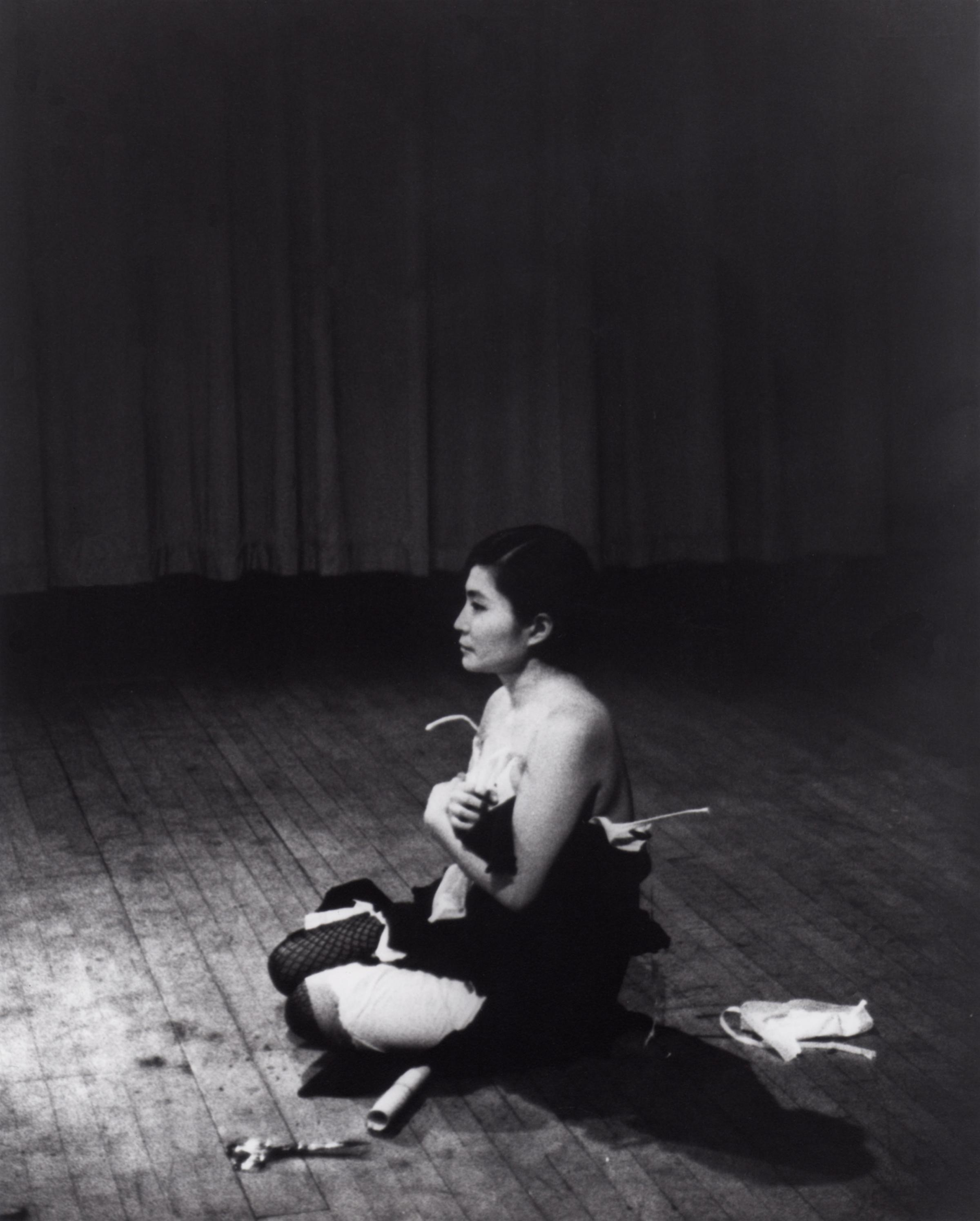 'Cut Piece' (1964) performed by Yoko Ono in New Works of Yoko Ono, Carnegie Recital Hall, New York, March 21, 1965. Photograph by Minoru Niizuma. © Minoru Niizuma. Courtesy Lenono Photo Archive, New York
