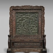 This heavily carved Chinese spinach jade rosewood tablescreen stands 32 inches high. It is estimated at $20,000-$25,000. I.M. Chait Gallery/Auctioneers images