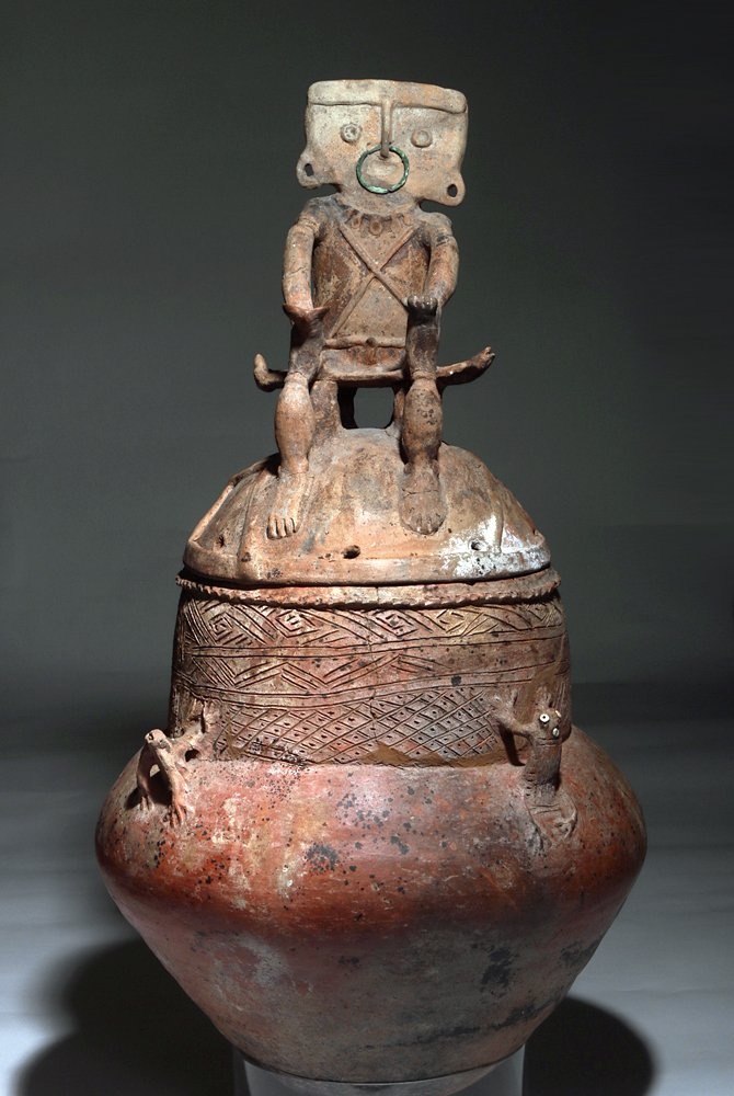 Lidded pottery urn, Rio Magdalena region of Colombia, circa 800 to 1500, 34 inches tall. Provenance: Laguna Niguel, California private collection; Sotheby's New York (Nov. 16, 2002), collection of the late Stanley Marcus. Estimate: $15,000-$20,000. Artemis Gallery image