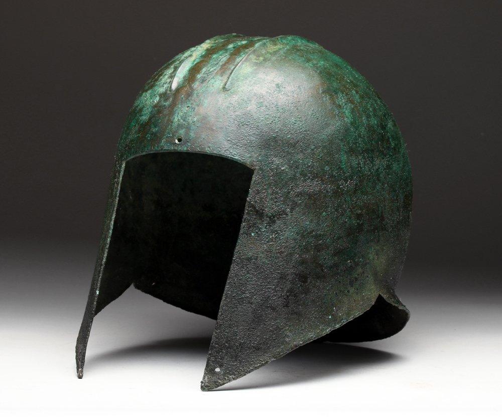 Greek Illyrian bronze helmet, circa late 6th to 5th century BCE, estimate $20,000-$30,000. Artemis Gallery image