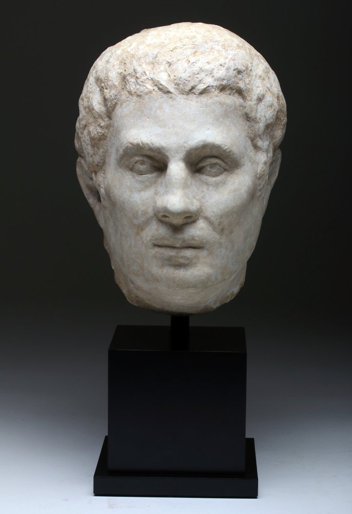 Large Ancient Roman marble head of a man, circa 1st to 3rd century CE, estimate $20,000-$30,000. Artemis Gallery image