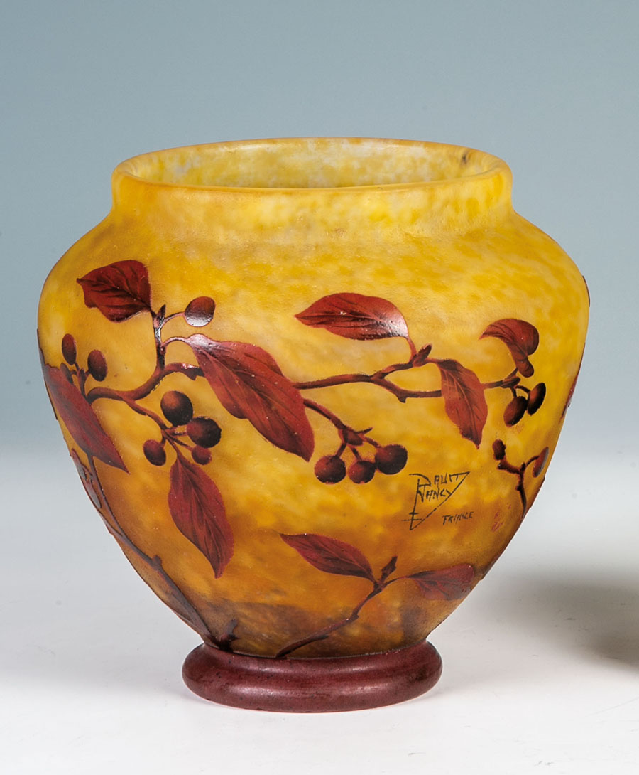 Lot 660 a yellow vase with sprays of foliage, Daum Frères, Nancy, with Lothringer Kreuz, circa 1914. Estimate: 1,800-2,500 euros. ($2,025-$2,800). Photo courtesy of Dr. Fischer Kunstauktionen