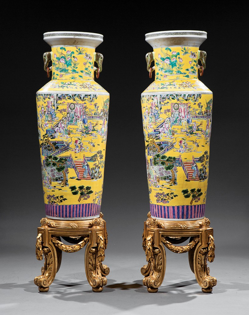 This 60-inch-high pair of Chinese clobbered famille rose porcelain vases from the 19th or 20th century sold recently for $4,780 at a Neal auction in New Orleans. They have multicolored decorations and a yellow ground.