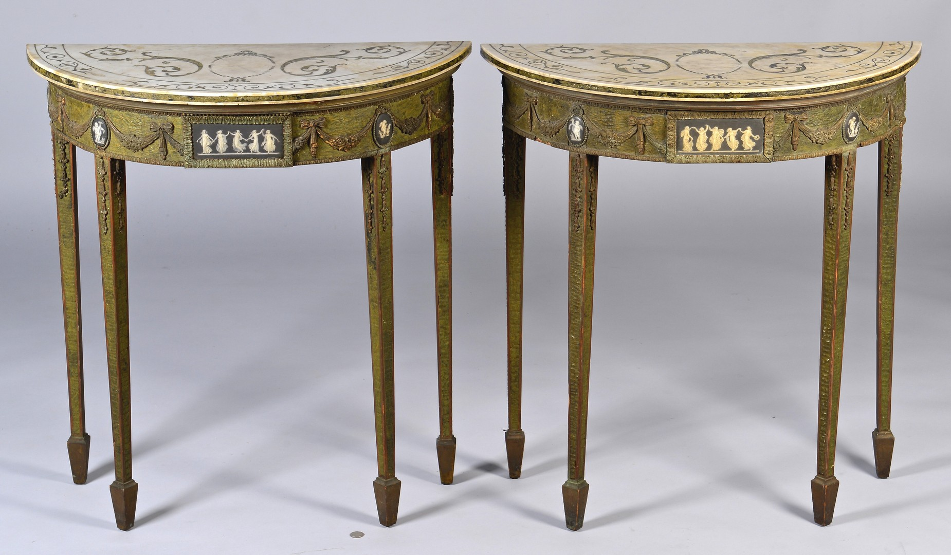 Two Robert Adam-style painted console tables have Wedgwood plaques and Scagliola inlaid marble tops. Estimate: $2,400-3400.Case Antiques Auction image