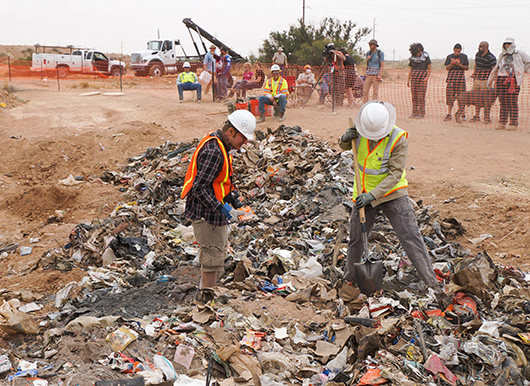 Workers uncover Atari games in a New Mexico landfill in 2013. Image by taylorhatmaker. This file is licensed under the Creative Commons Attribution 2.0 Generic license.