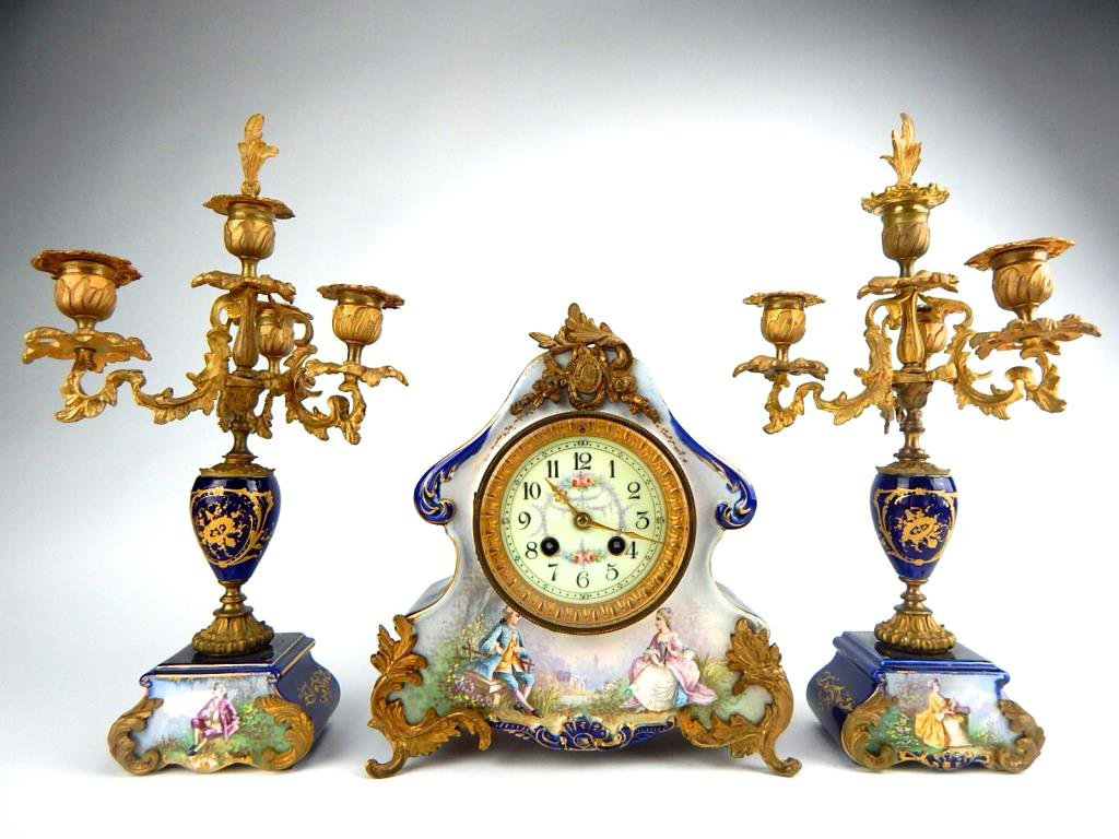 Sevres porcelain clock set. 'Made in France' scrolled on back of clock, movement 'S. Marti et Cie Medaille D'Argent 1889.' Estimate $1,500-$1,800. Don Presley Auctions image