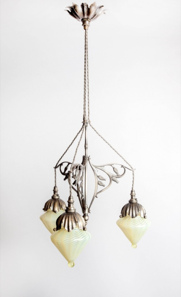Oxford auctioneers Mallams took a winning bid of £23,000 for this magnificent ceiling light with three suspended lights and opalescent shades by James Powell & Co. Photo Clare Borg-Cook