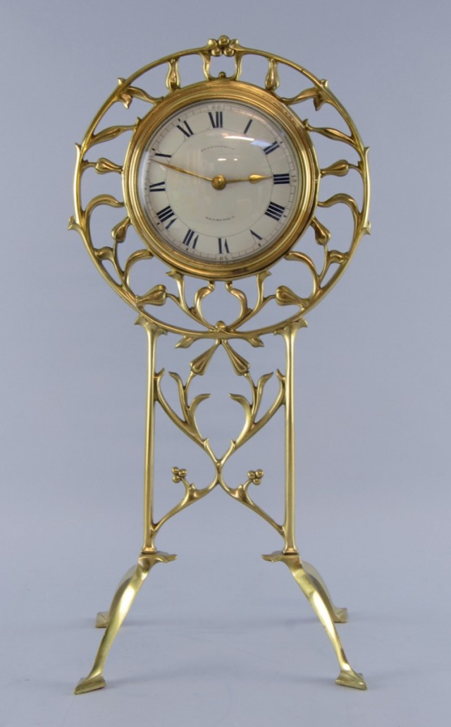 The mantel clock in a Benson brass frame formed by branches and flower heads. It sold for £5,600. Photo Ewbank's auctioneers
