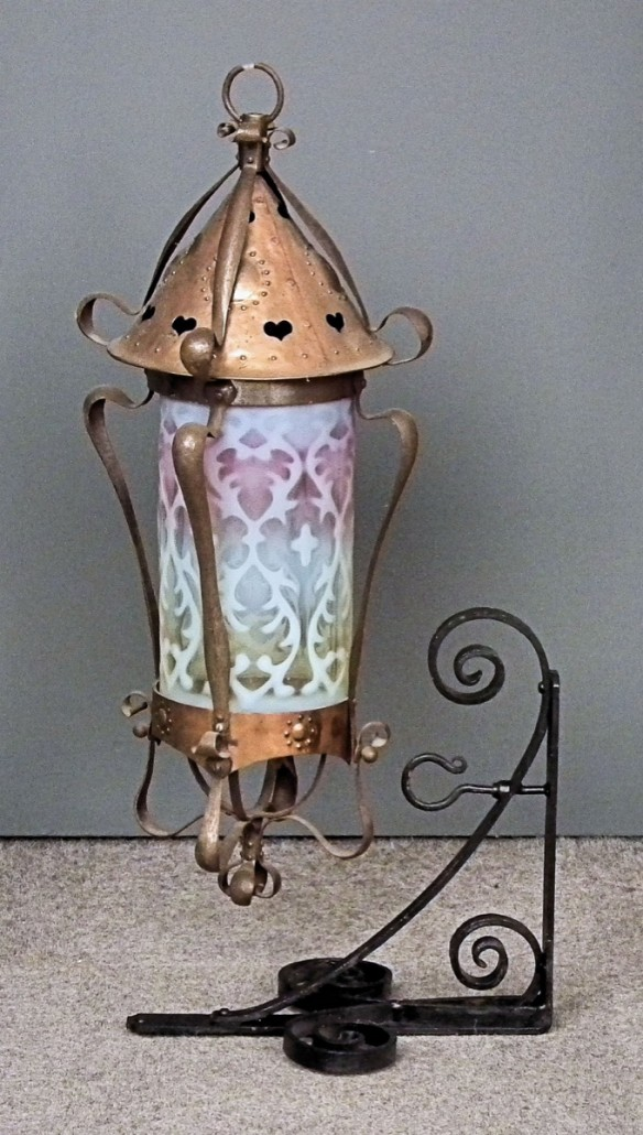 A copper hanging lantern with James Powell & Co. glass shade, sold for £800. Photo The Canterbury Auction Galleries