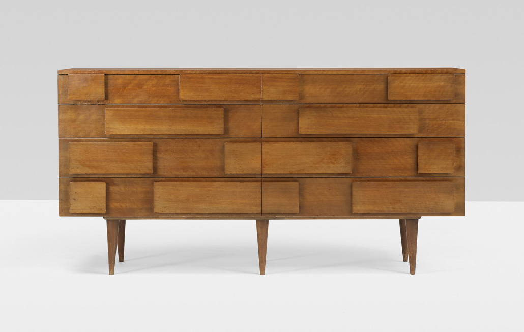 In the 1950s, Ponti created furniture designs for M. Singer & Sons, New York-Chicago. This Italian walnut cabinet with eight drawers (W. 72 in) appears in the firm's catalogs from that era. Courtesy Wright.