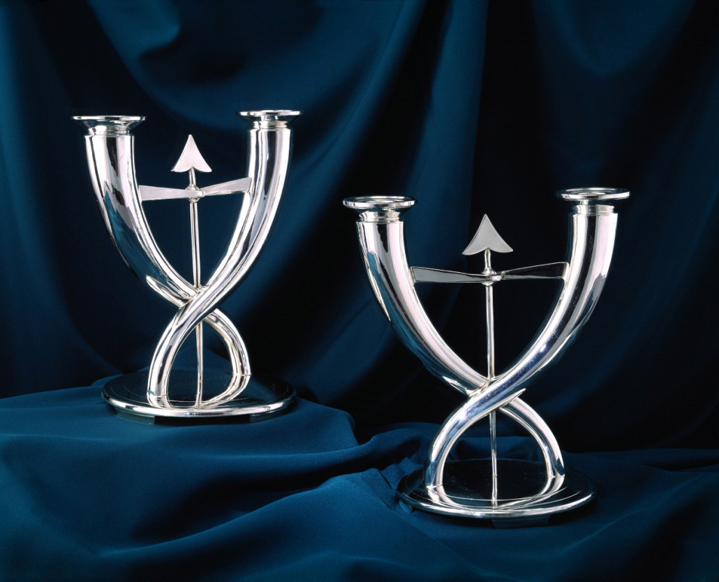 These silver-plated candlesticks in the Fleche or Arrow pattern (H. 10 in) were manufactured circa 1933 by the French firm of Christofle, with which Ponti collaborated for over 40 years. Courtesy Denver Art Museum.
