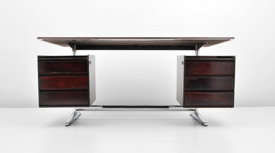 A Ponti design for a floating rosewood and chromed steel desk was part of a group of furniture commercially produced by Rima in Padua, Italy. Courtesy Palm Beach Modern Auctions.