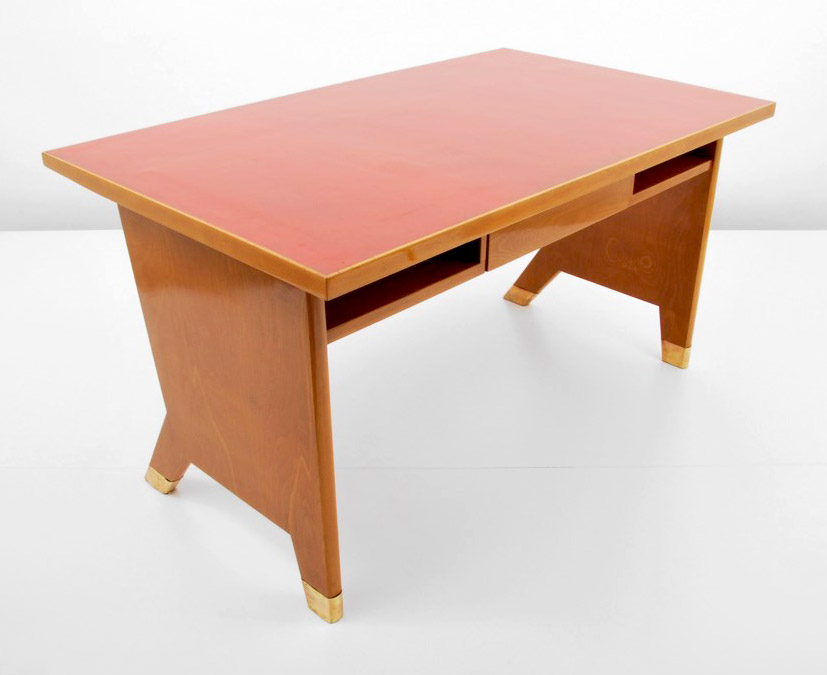 This administrator's desk of fruitwood, laminate, beech and brass, circa 1950, accompanied by a certificate from the Ponti archives, was sold at Palm Beach Modern in 2013. Courtesy Palm Beach Modern Auctions.