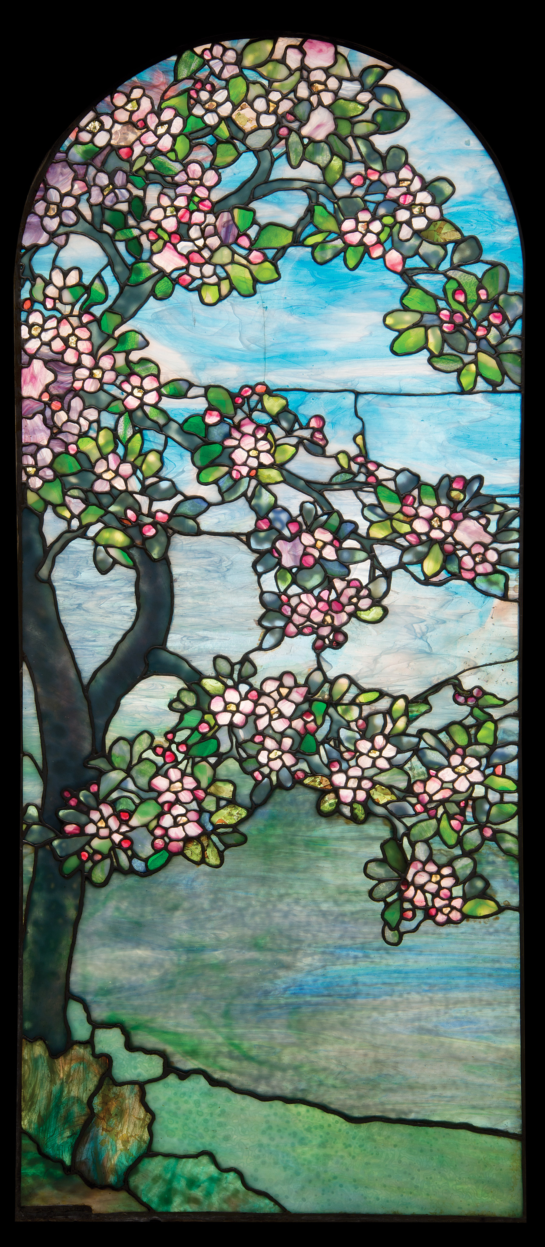 912361bb9c0 Floral themes with precise renderings of different blossoms were popular  for both lamp shades and windows