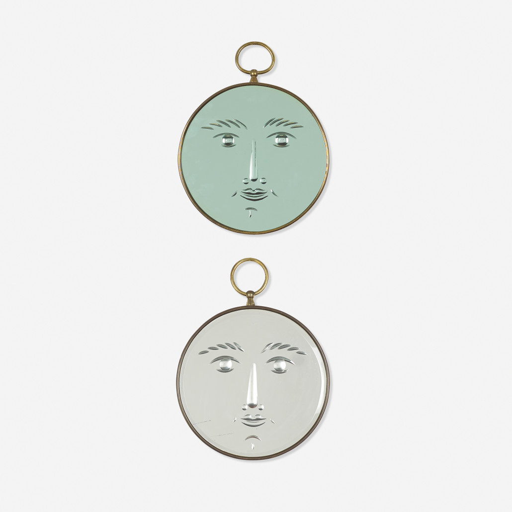 Fascinated by faces, the designer set them on a pair of brass-bound mirrors, circa 1950. One bears the identifying label 'Fornasetti Milano Made in Italy.' Courtesy Wright Auctions.