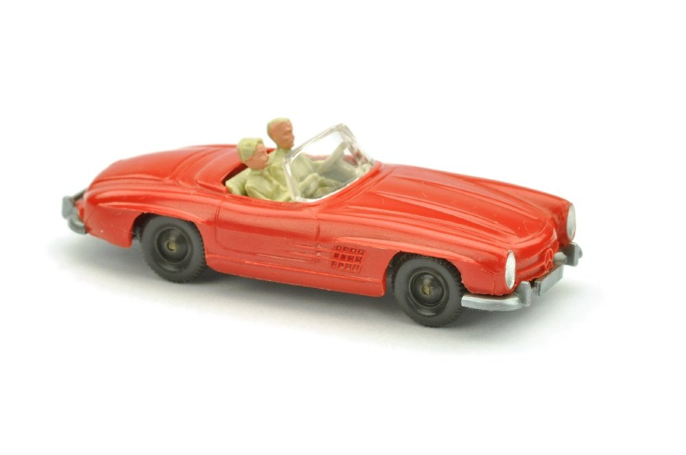 Out for a jaunt in a red Wiking Mercedes 300SL convertible, which is lot 8139 in Auktionshaus Saure's 64th auction. Photo courtesy of Auktionhaus Saure.