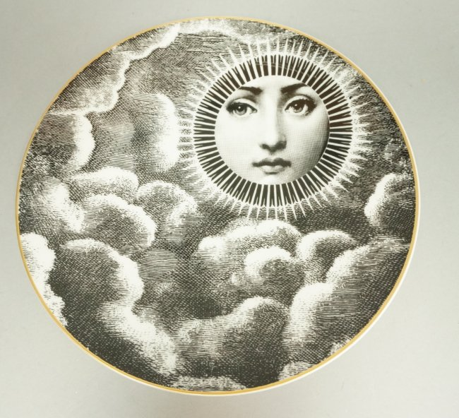 Inspired by a photo of the Italian soprano Lina Cavalieri (1875-1944), Fornasetti created hundreds of porcelain plates – a series he called 'Tema e Variazioni' – decorated with surrealistic and trompe l'oeil variations on her beautiful face. The plates turn up frequently at sales and remain an affordable approach to the designer. Courtesy Uniques.