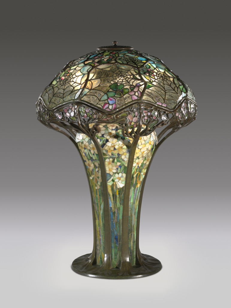 Introduced around 1900, the Cobweb or Spiderweb lamp was one of Tiffany's most intricate designs. The broad mosaic-decorated base originally held combustible fuel while later examples were illuminated with three electric lightbulbs. Difficult to produce and expensive to purchase when made – a steep $500 – the design is at the top of any collector's wish list. Courtesy of the Virginia Museum of Fine Arts