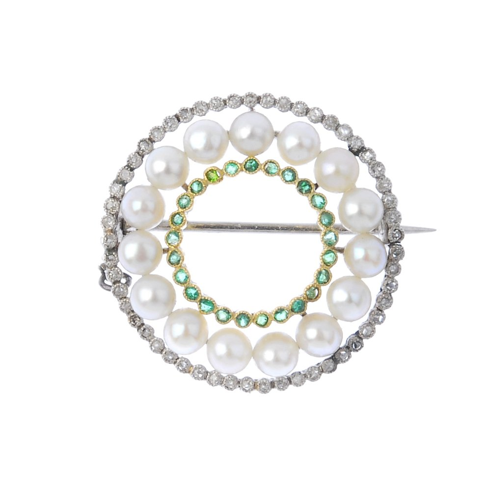 An early 20th century platinum and 18K gold seed pearl, diamond and emerald wreath brooch. Estimate: £700–£900. Fellows image