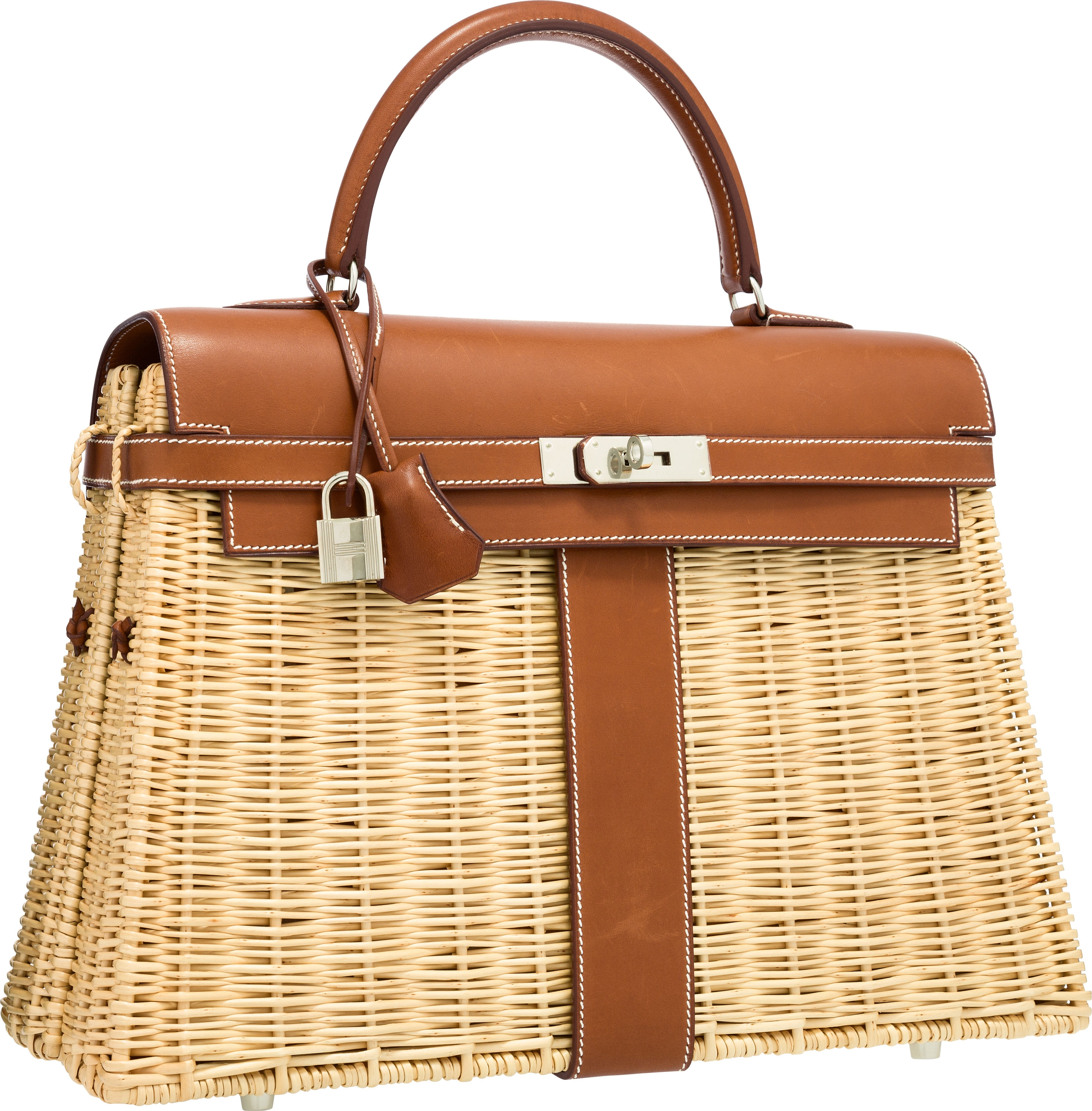 b5aab1a71381 The 35 cm Picnic Kelly in leather and wicker with Palladium hardware was  part of a