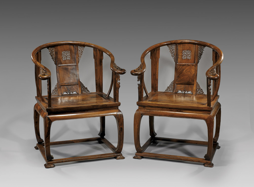 This antique pair of Chinese carved huanghuali wood armchairs with intricately carved backsplat and curvilinear arms ending in a scrolled flourish brought $43,760 at I.M. Chait in 2013. Courtesy I.M. Chait Auctioneers, Beverly Hills, Calif.