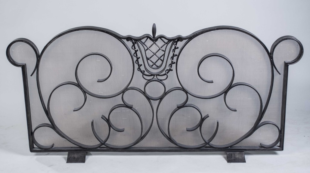 Andre Arbus-style wrought iron fire screen by Raymond Subes, 60 in wide x 29 1/2in high. Estimate: $5,000-$7,000. Capo Auction image