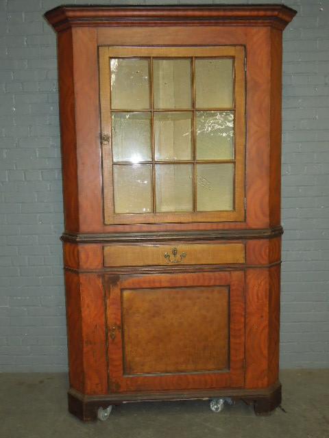 American grain-painted corner cupboard, 84 1/2in high x 48 1/4in wide. Estimate: $4,000-$6,000. Barry S. Slosberg Inc. image