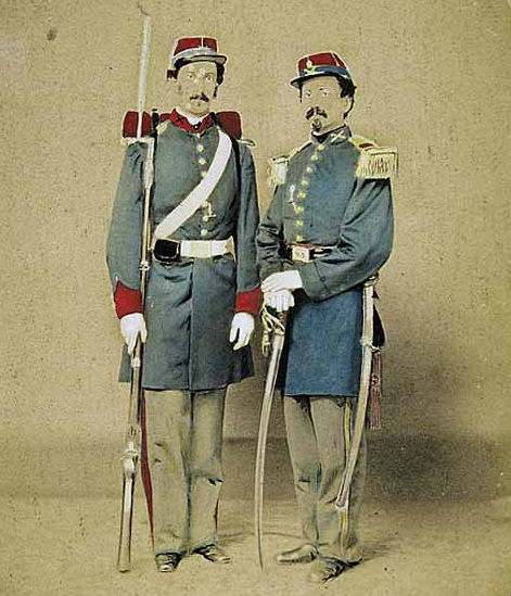 A hand-colored albumen print shows two confederate soldiers wearing frock coats. Image courtesy of LiveAuctioneers.com archive and Neal Auction Co.