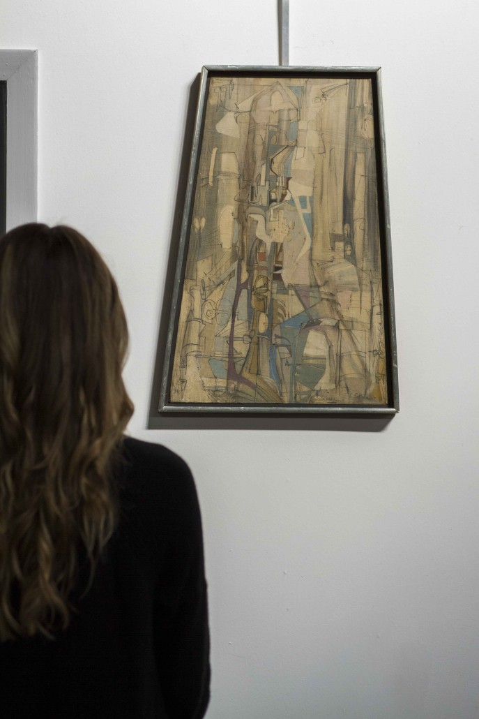 Sonja Sekula's 'Les Dernier Chateau' draws an admirer at Myers Fine Art gallery in St. Petersburg, Florida. The 1947 painting is expected to make $4,000-$6,000 in the company's March 13, 2016 auction.