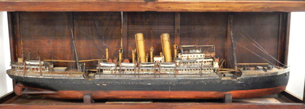 Circa-1900 wood and metal ship model in display case