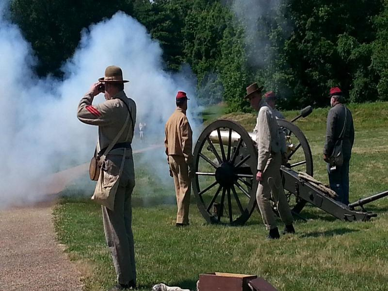 Petersburg National Battlefield re-enactors representing the Confederate Unit Pegram's Battery demonstrate how a 12 pounder Napoleon cannon was fired. Image courtesy NPS