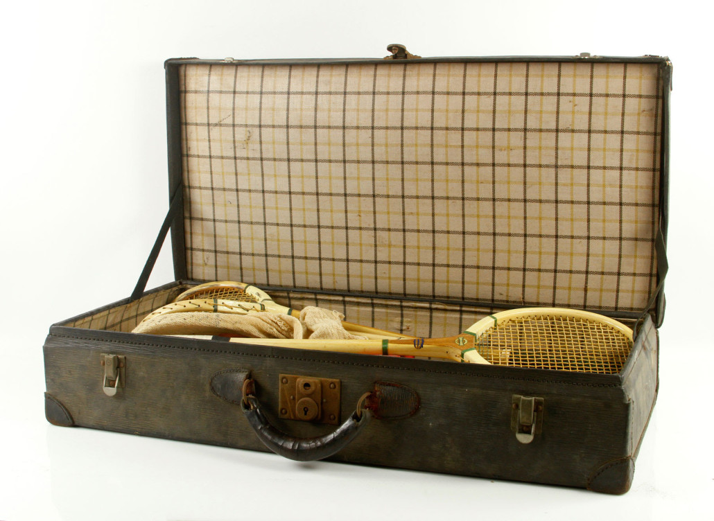 Eleonora Sears' squash rackets and tennis balls in a vintage suitcase. The lot sold for $9,000. Kaminski Auctions image